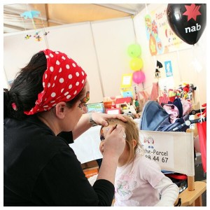 Face painting at corporate function